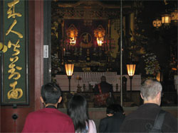 Monks at pray inside Sensoji Temple